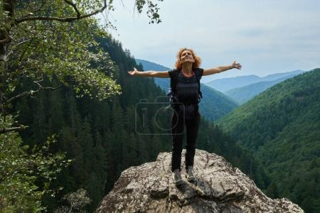 woman on mountain peak