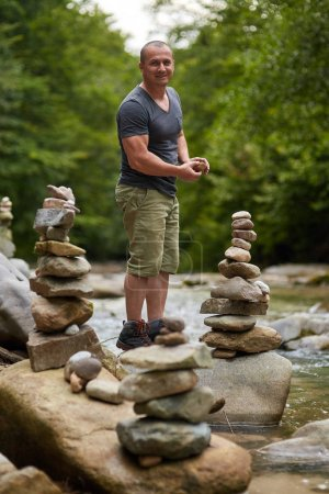 Man building stone towers