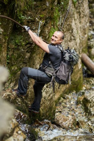Man climbing on safety chains