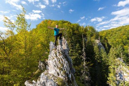 Happy man on cliff