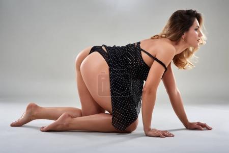 Photo for Glamour model on gray background, studio shot - Royalty Free Image