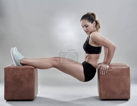 Woman doing dips for triceps
