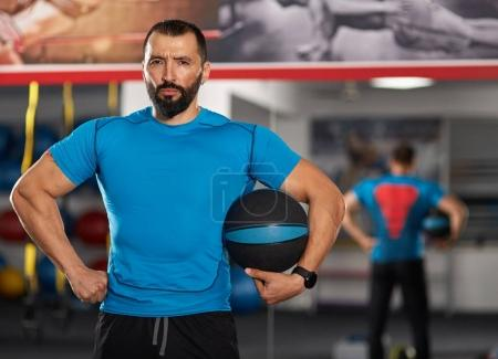 Fitness trainer with medicine ball