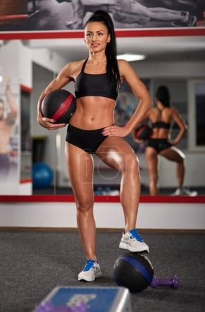 Fitness model posing in a gym