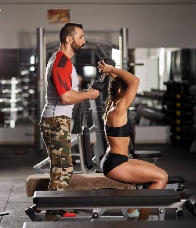 Personal trainer at work in the gym