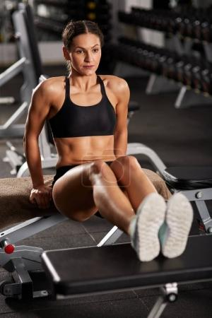 Athletic woman doing abs crunches