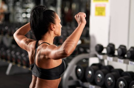 Woman warming up for shoulder workout