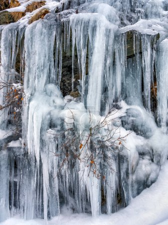 Landscape with a frozen watefall in the mountains