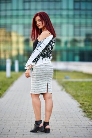 Young caucasian woman wearing skirt and black top