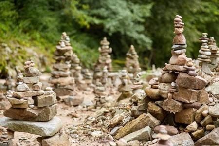 River pebbles arranged in artistic zen-like stacks