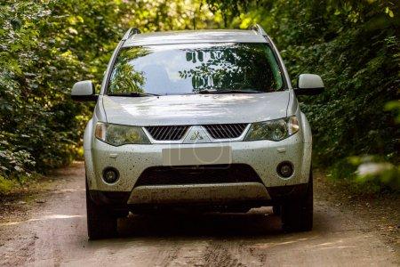 Comana, Romania, September 1, 2016: white Mitsuhishi Outlander 4x4 SUV on a dirt road