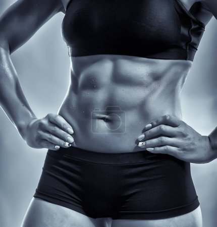 Anonymous muscular female stomach with sixpack abs