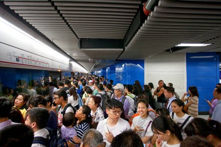 People traveling in the Hong Kong subway
