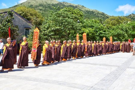 Monks in front of Big Buddha in Lantau Island
