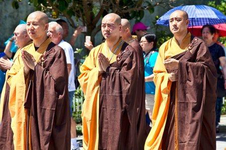 Monks in front of Big Buddha in Lantau Island