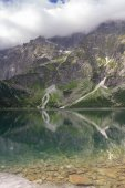 Morskie Oko lake in Polish Tatra mountains on cloudy day in summer
