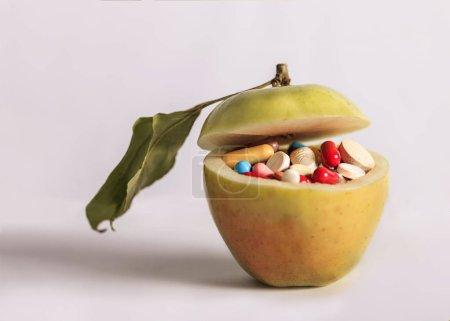Open ripe organic yellow apple full of colorful medicines
