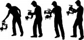 videographer with handheld steadycam silhouettes