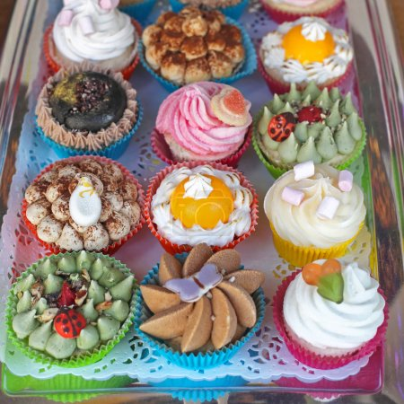 Photo for Selection of Colourful Cupcakes in Tray - Royalty Free Image