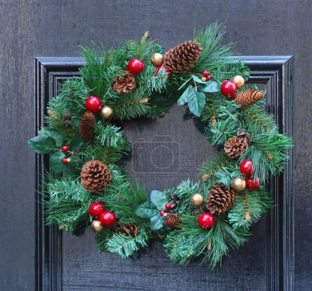Photo for Christmas Wreath Decoration at Black Door - Royalty Free Image