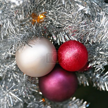 Photo for Christmas Ornaments Cluster Decoration in Tinsel - Royalty Free Image