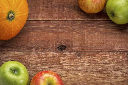 rustic barn wood with pumpkin and apples