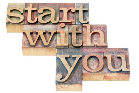 Photo for Start with you motivational advice - isolated text in letterpress wood type - Royalty Free Image