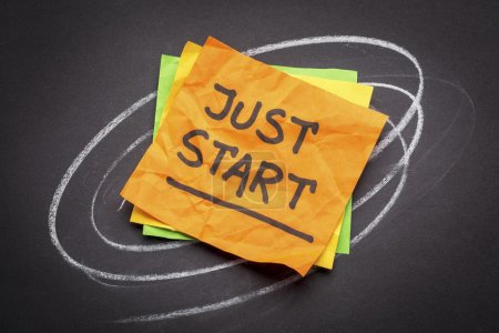 Photo for Just start advice or reminder - handwriting on a sticky note against black paper - Royalty Free Image