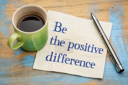 Photo for Be the positive difference - handwriting on a napkin with a cup of espresso coffee - Royalty Free Image