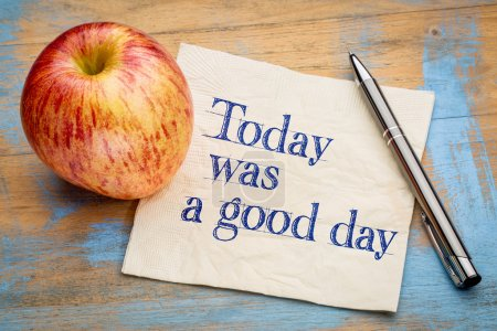 Photo for Today was a good day positive affirmation - handwriting on a napkin with a fresh apple - Royalty Free Image