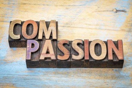 Photo pour Compassion - mot abstrait en bois de typographie vintage contre le bois peint grunge - image libre de droit