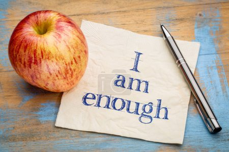 Photo for I am enough positive affirmation - handwriting on a napkin with a fresh apple - Royalty Free Image