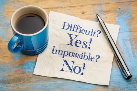 Photo for Difficult? Yes! Impossible? No! - handwriting on a napkin with a cup of espresso coffee - Royalty Free Image