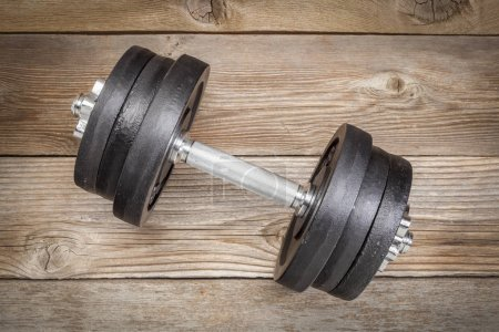 cast iron dumbbell on wood