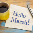 Hello March - handwriting on a napkin with a cup o...