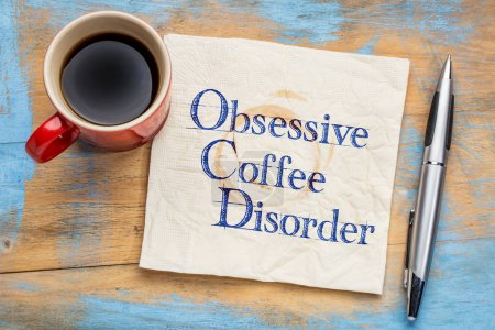 Photo for Obsessive coffee disorder (OCD) - handwriting  on a napkin with a cup of coffee - Royalty Free Image