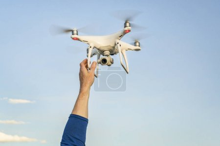 Photo for CARR, CO, USA - APRIL 12, 2017:  Launching DJI Phantom 4 pro quadcopter drone - operator hands and drone against sky. - Royalty Free Image