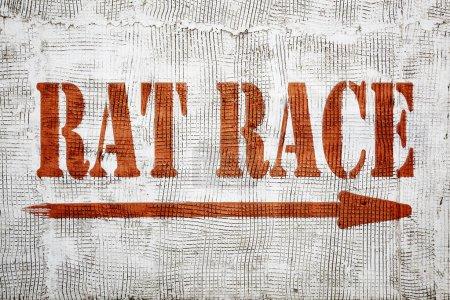 Rat race graffiti on stucco wall