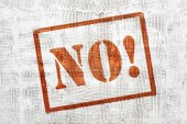NO! Graffiti on white stucco wall