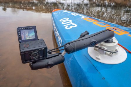 Photo for Fort Collins, CO, USA - December 25, 2019: Sony RX0 2 ultra compact action  camera mounted with a suction cup on a deck of racing stand up paddleboard. - Royalty Free Image