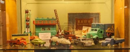 KIEV, UKRAINE - AUGUST 1, 2017: Metal and wooden toys produced in Ukraine 50s  in the Toy Museum, Kiev, Ukraine
