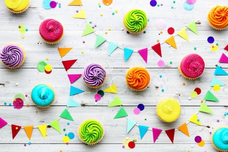 Photo for Colorful cupcake party background - Royalty Free Image