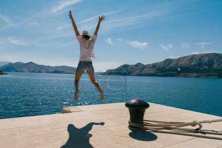 Happy woman jumping on vacation