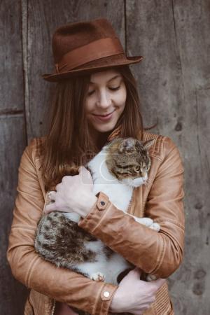 Cute cat in hand