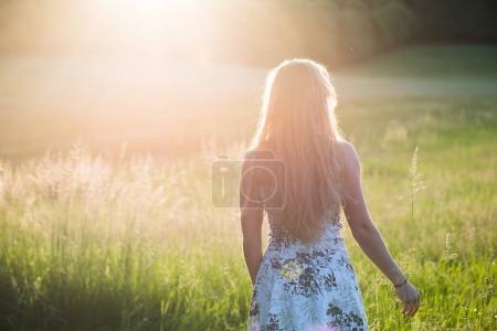 Teenage girl enjoy with sun in the evening glow
