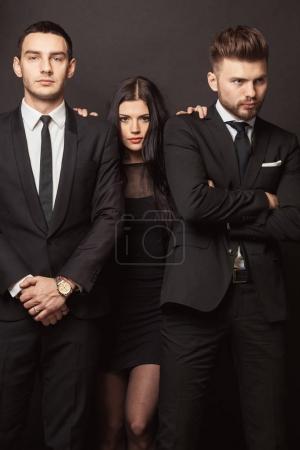 Beautiful female celebrity with bodyguards