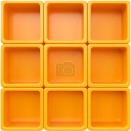 Empty orange plastic shelves