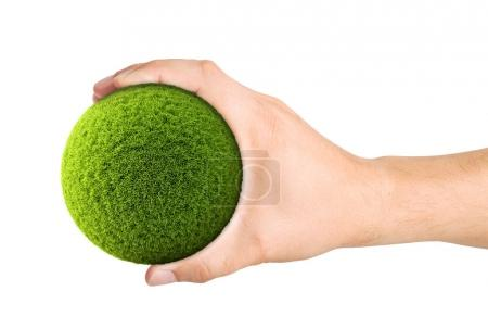 Green ball from grass on a palm. Isolated on white background. 3D illustration.