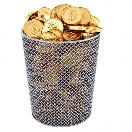 Waste basket with golden bitcoin coins isolated on white background.