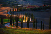 Tuscany, rural sunset landscape.Countryside farm,cypresses trees